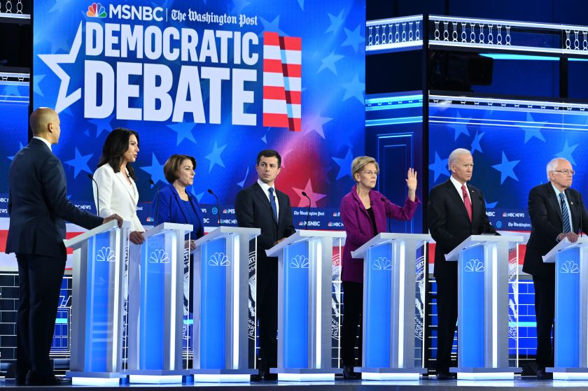 From left, Cory Booker, Tulsi Gabbard, Amy Klobuchar, Pete Buttigieg, Elizabeth Warren, Joe Biden and Bernie Sanders in Atlanta on Nov. 20.(AFP via Getty Images)