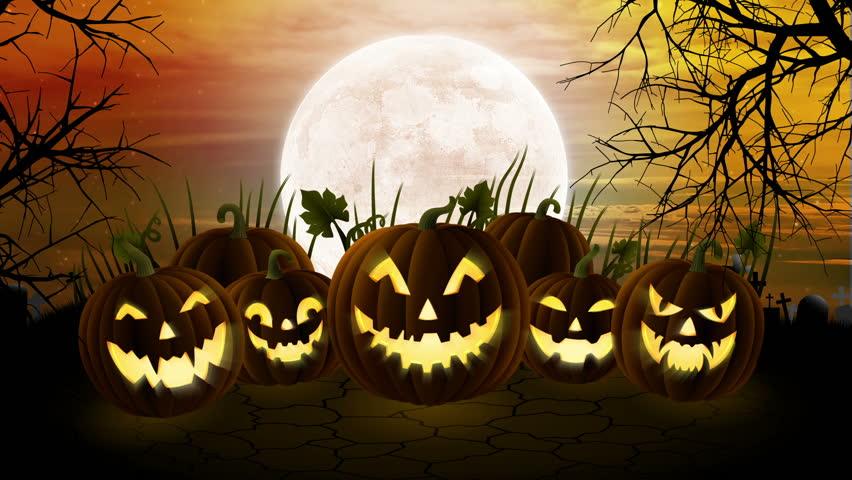 Five+scary+Halloween+pumpkins+stare+menacingly+toward+you+under+a+full+moon.+