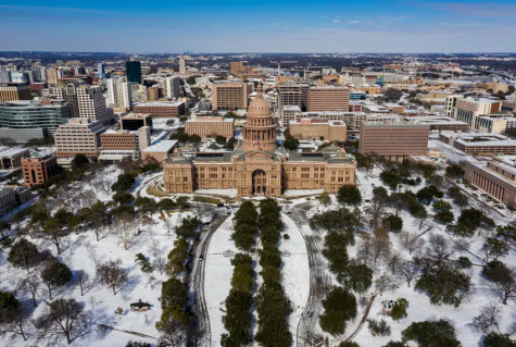 Snow falls on the capitol building in Austin, Texas